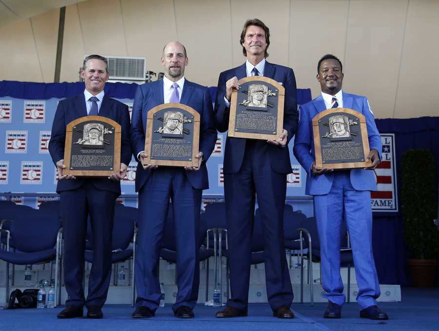 Newly-inducted National Baseball Hall of Famers from left to right, Craig Biggio, John Smoltz, Randy Johnson and Pedro Martinez hold their plaques after an induction ceremony at the Clark Sports Center on Sunday, July 26, 2015, in Cooperstown, N.Y. (AP Photo/Mike Groll)