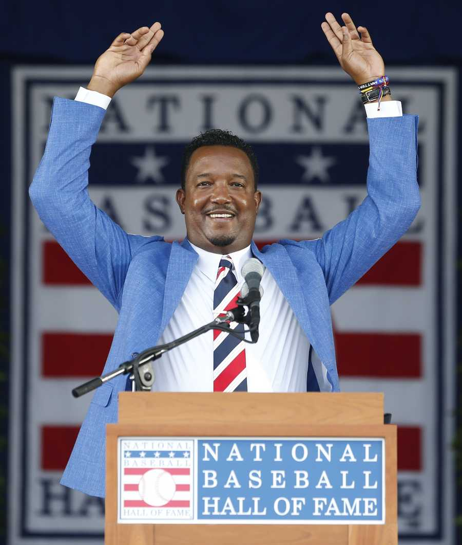 National Baseball Hall of Fame inductee Pedro Martinez speaks during an induction ceremony at the Clark Sports Center on Sunday, July 26, 2015, in Cooperstown, N.Y. (AP Photo/Mike Groll)