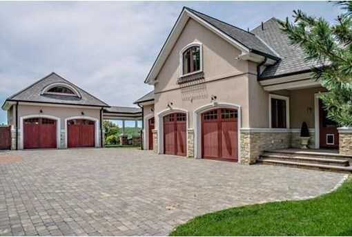 """A """"French Country Manor"""" on a spectacular 3.4 acre gated estate."""