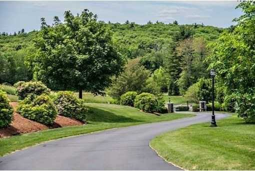 Expertly landscaped, with gorgeous stone walls and 50+ mile westerly views.