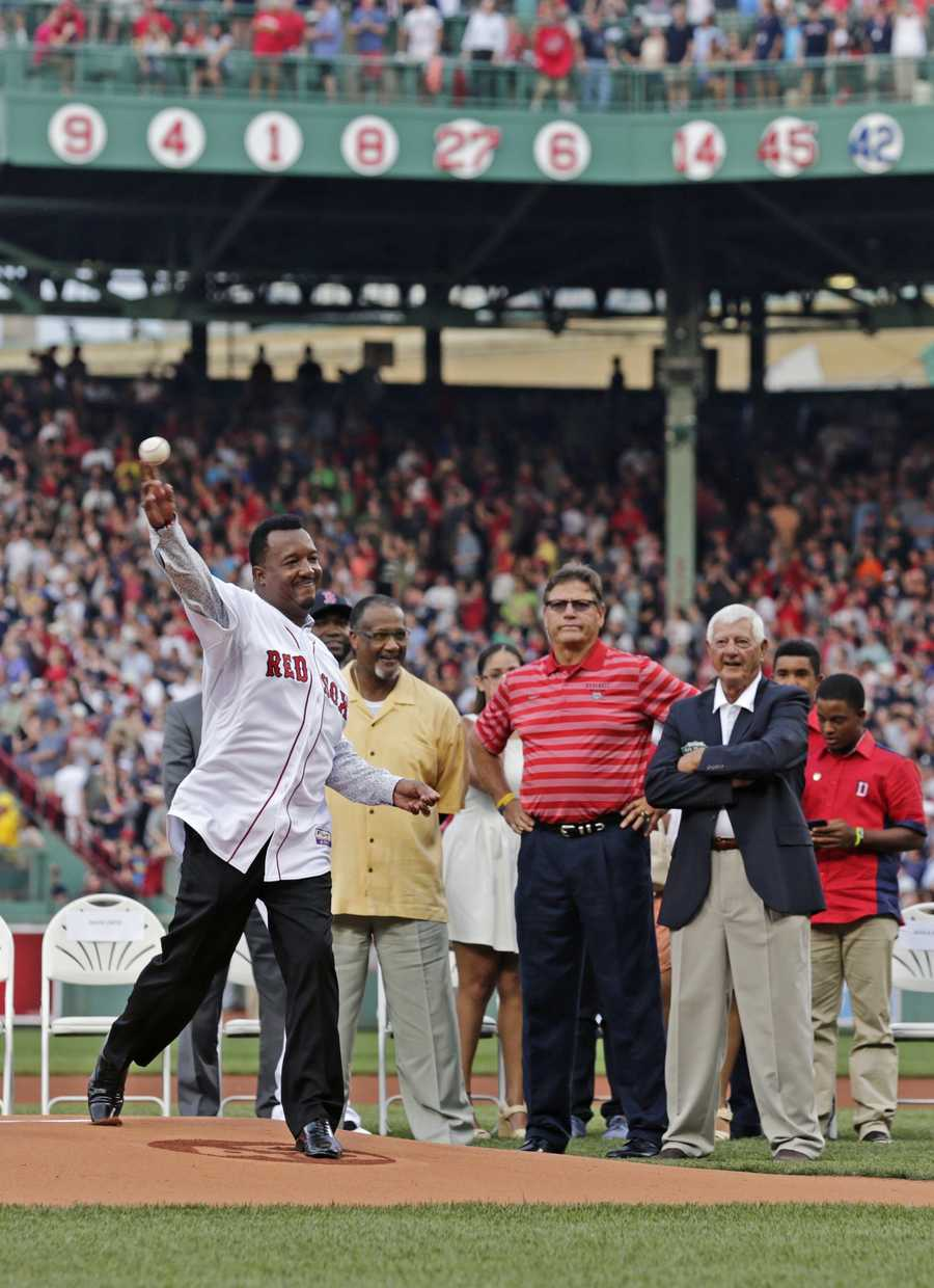 Boston Red Sox Hall of Fame pitcher Pedro Martinez throws out the ceremonial first pitch after his jersey number 45 was retired prior to a baseball game at Fenway Park in Boston, Tuesday, July 28, 2015. (AP Photo/Charles Krupa)