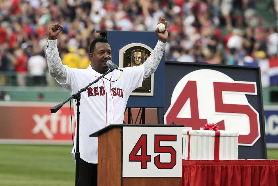 Boston Red Sox Hall of Fame pitcher Pedro Martinez raises his arms during a ceremony where his #45 was retired prior to a baseball game at Fenway Park in Boston, Tuesday, July 28, 2015. (AP Photo/Charles Krupa)