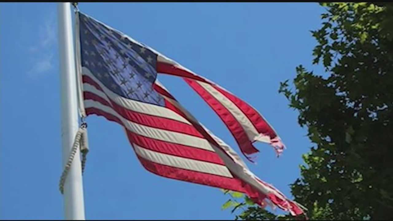 A tattered U.S. flag flying in front of the Huntington, Vt. post office this summer has sparked a series of complaints, which seemed to be ignored until a passerby had an idea Friday.
