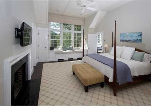 A master bedroom suite with luxurious master bath & walk in closets.