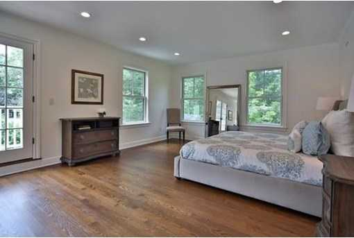 Unique master suite w/sitting  area,french doors to deck,gas fplce, 2 WI closets & 4 piece marble bath.