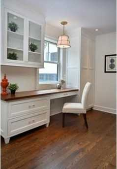 Custom built-in desk area, mudroom and powder room complete this level.