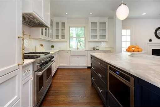 The kitchen is stunning w/ marble counters, large eating island and high-end appliances & finishes