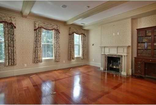 Gorgeous wood floors throughout, multiple fireplaces 2 parking spaces.