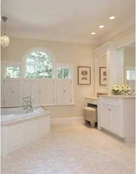 His and Hers baths and dressing rooms in a luxurious over the top Master Suite.