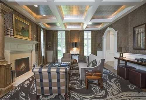 Custom walnut paneled formal study with fireplace, coffered ceilings and exquisite details
