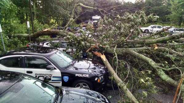 Trees down on Barrington, Rhode Island, police cars on Tuesday.