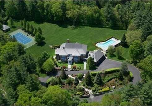Enter through stone pillars and arrive at a Majestic Brick Georgian Manor with slate roof on 3+ acres of gorgeous level land with over sized swimming pool, tennis court and car barn.