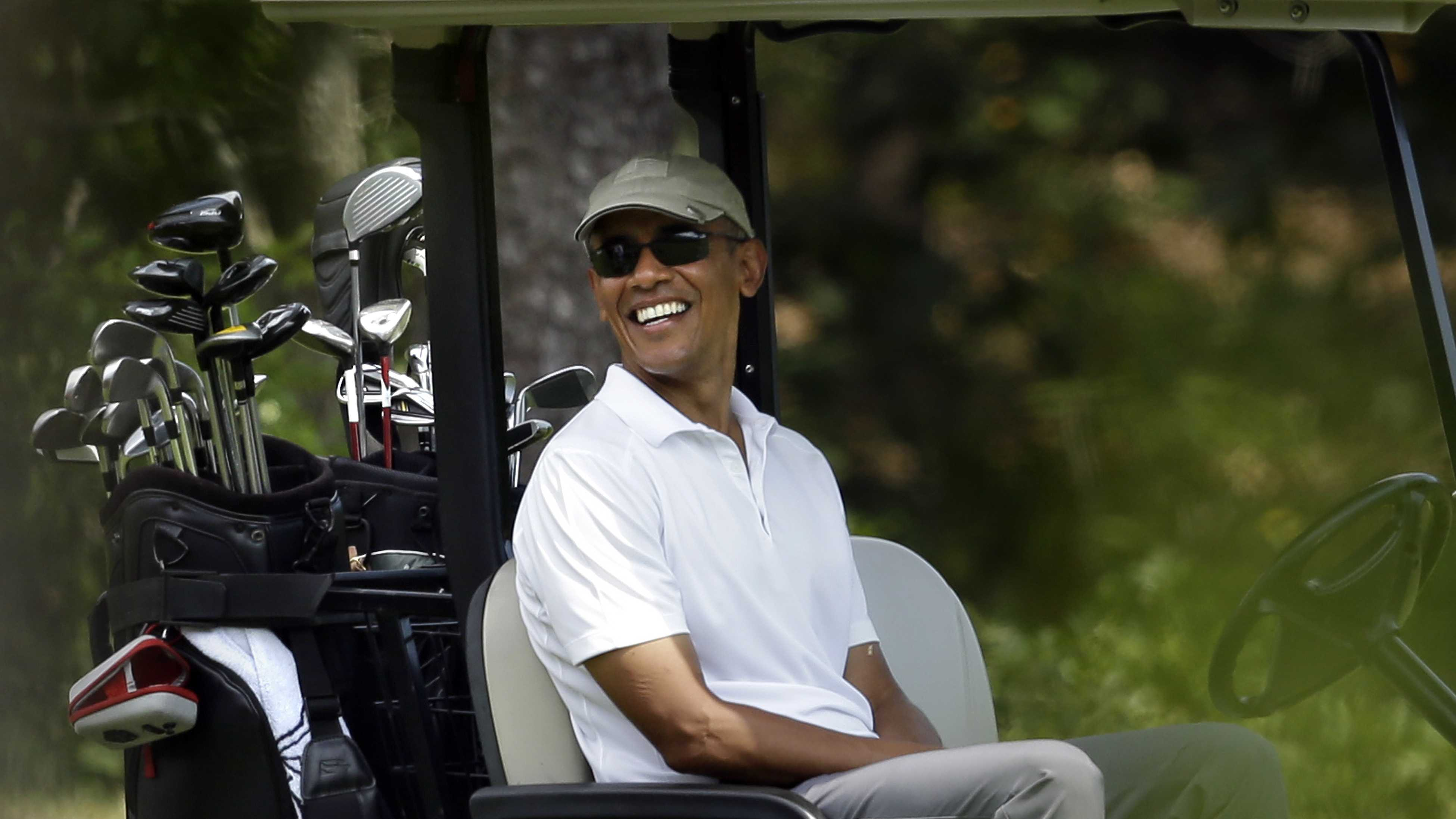 President Barack Obama smiles as he sits in a cart while golfing Saturday, Aug. 15, 2015, at Farm Neck Golf Club, in Oak Bluffs, Mass., on the island of Martha's Vineyard.