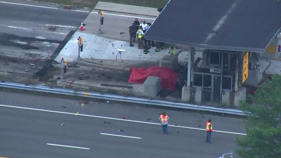A vehicle crashes into a toll plaza along the Everett Turnpike in Merrimack, New Hampshire Thursday.
