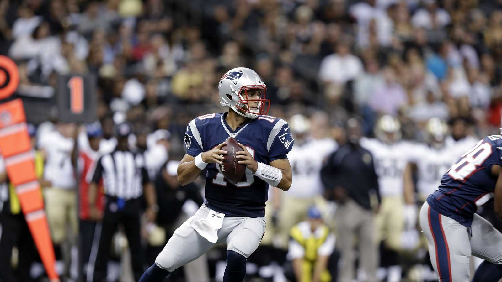 New England Patriots quarterback Jimmy Garoppolo (10) drops back to pass in the second half of an NFL football game against the New Orleans Saints in New Orleans, Saturday, Aug. 22, 2015.