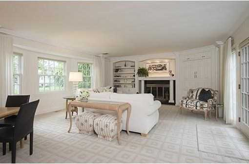 Offering a welcoming foyer, grand living room with handsome fireplace, built-ins and French doors leading to the patio.