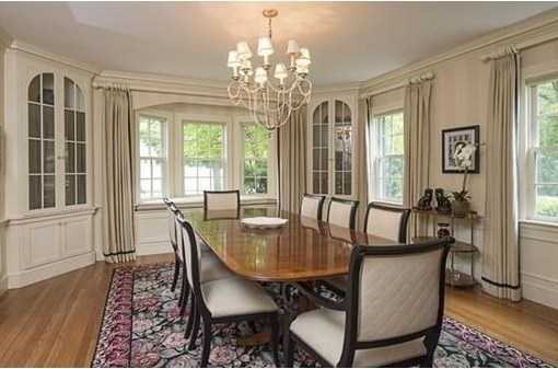 The gracious dining room has a lovely built in window seat and wainscoting.