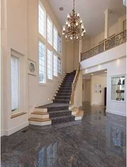 Sun filled interior space with 20' high grand entry hall, an open floor plan, luxurious Master Suite with Dressing Room, lower level separate in-law suite and four car garage.
