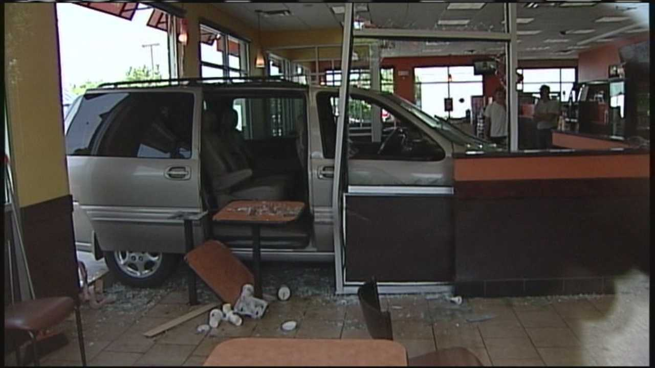 A van crashed into a Dunkin' Donuts store in Biddeford on Saturday morning.