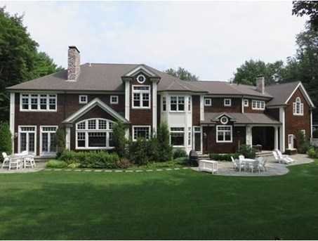 Exquisite designer decorated shingle style home custom built in 2009 on 1.4 acres in premier southside neighborhood. Meticulous design, many architectural details.