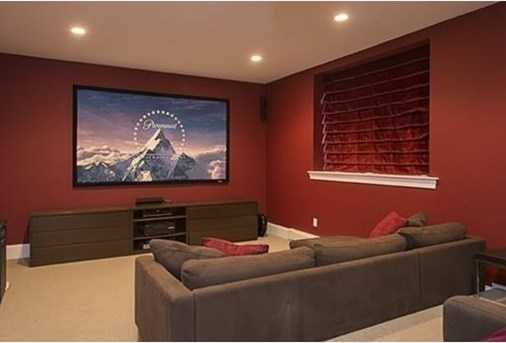 Finished lower level with wine cellar, Read more home theater, full bath, sauna, exercise & playroom.