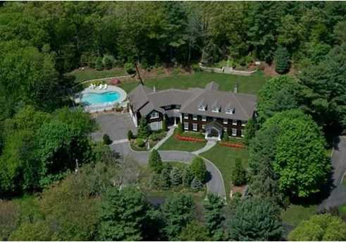 Circular drive, gorgeous professionally landscaped grounds. In-ground pool with bluestone patio.