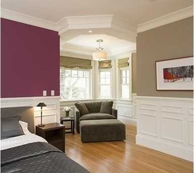 Luxurious master suite with sitting area & fireplace.