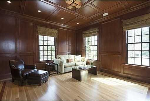 Custom cherry library with paneling, coffered ceilings & built-ins.