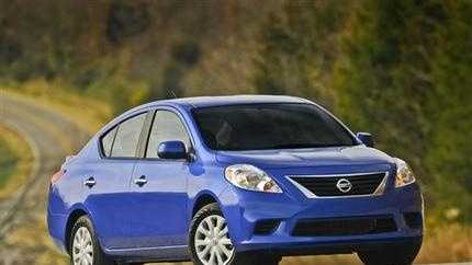 This photo provided by Nissan shows the 2013 Nissan Versa. Nissan is recalling nearly 300,000 of its Versa and Versa Note vehicles to adjust a console panel that could catch the driver's shoe and slow braking speed. The recall involves Versa sedans made between June 9, 2011, and March 11, 2015, and Versa Note vehicles made between April 23, 2013 and March 11, 2015.