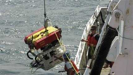 In this photo provided by the University of Rhode Island, scientists deploy a remotely operated submersible vehicle Friday, Sept. 4, 2015, to explore a German U-boat that sank at the end of World War II several miles off the Rhode Island coast. Scientists from the University's Inner Space Center, Connecticut's Ocean Exploration Trust and the U.S. Coast Guard Academy are attempting the exploration during a five-day trip that lasts through Sunday. (Alex DiCiccio/University of Rhode Island via AP)