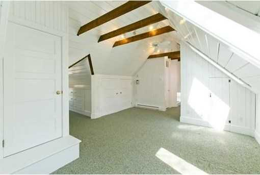 Expansive 3rd floor offers exposed beams and bead board in whimsical voluminous space with additional bedroom, exercise room and large gathering space.
