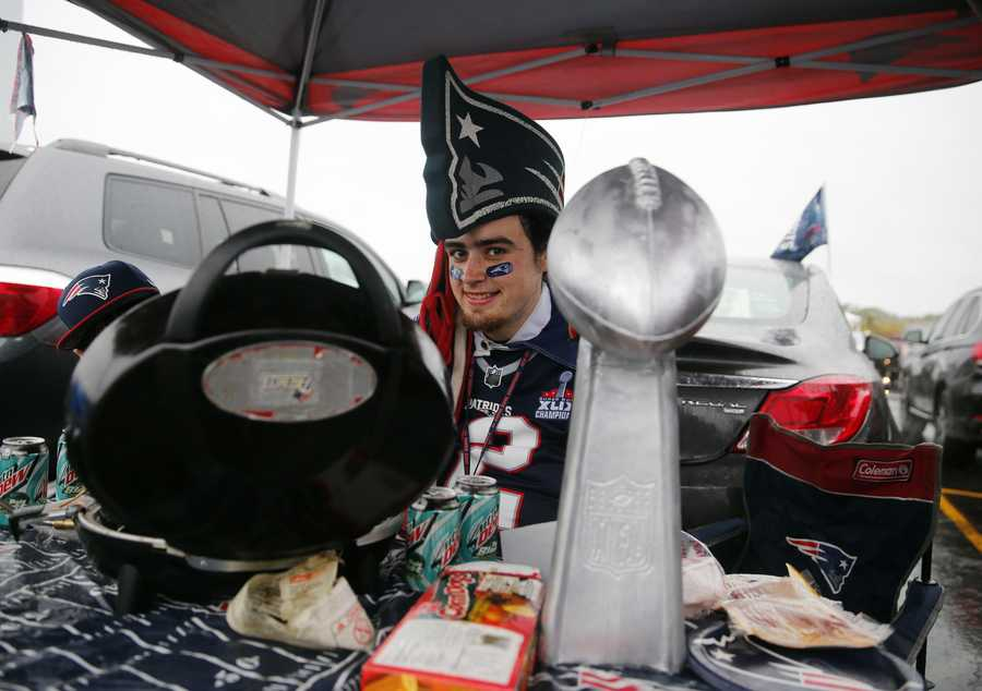 New England Patriots fan Sam Macasay spends time tailgating in the parking lot before an NFL football game against the Pittsburgh Steelers Thursday, Sept. 10, 2015, in Foxborough, Mass. (AP Photo/Winslow Townson)