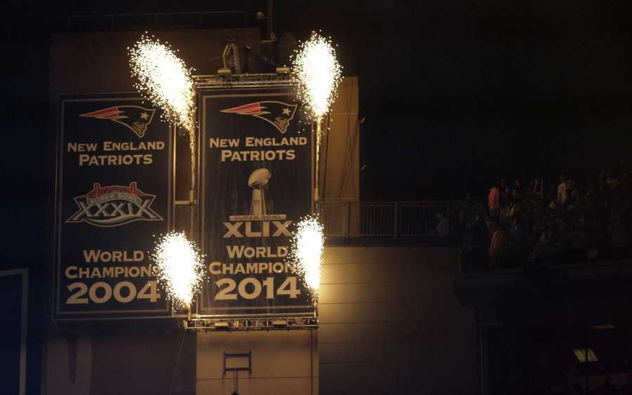 The New England Patriots unveil Super Bowl XLIX championship banner before an NFL football game against the Pittsburgh Steelers, Thursday, Sept. 10, 2015, in Foxborough, Mass. (AP Photo/Charles Krupa)