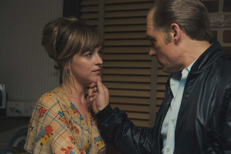 "(L-r) JOHNNY DEPP as Whitey Bulger and DAKOTA JOHNSON as Lindsey Cyr in the drama ""BLACK MASS,"" a presentation of Warner Bros. Pictures in association with Cross Creek Pictures and RatPac-Dune Entertainment, released by Warner Bros. Pictures."