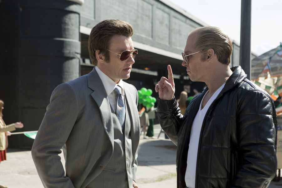 "(L-r) JOEL EDGERTON as FBI Agent John Connolly and JOHNNY DEPP as Whitey Bulger in the drama ""BLACK MASS,"" a presentation of Warner Bros. Pictures in association with Cross Creek Pictures and RatPac-Dune Entertainment, released by Warner Bros. Pictures."