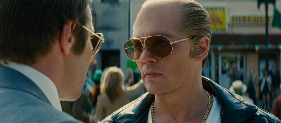 "(L-r) JOEL EDGERTON as FBI Agent John Connolly and JOHNNY DEPP as Whitey Bulger in the drama ""BLACK MASS a presentation of Warner Bros. Pictures in association with Cross Creek Pictures and RatPac-Dune Entertainment, released by Warner Bros. Pictures."