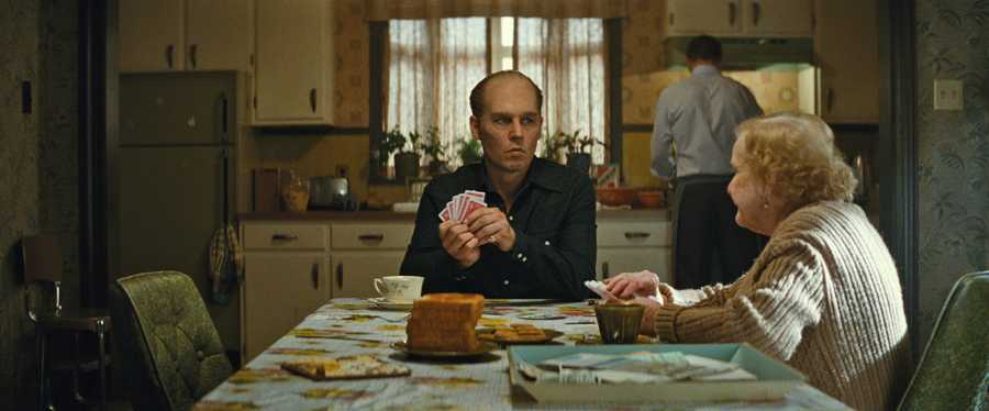 "(L-r) JOHNNY DEPP as Whitey Bulger and MARY KLUG as Ma Bulger in the drama ""BLACK MASS,"" a presentation of Warner Bros. Pictures in association with Cross Creek Pictures and RatPac-Dune Entertainment, released by Warner Bros. Pictures."