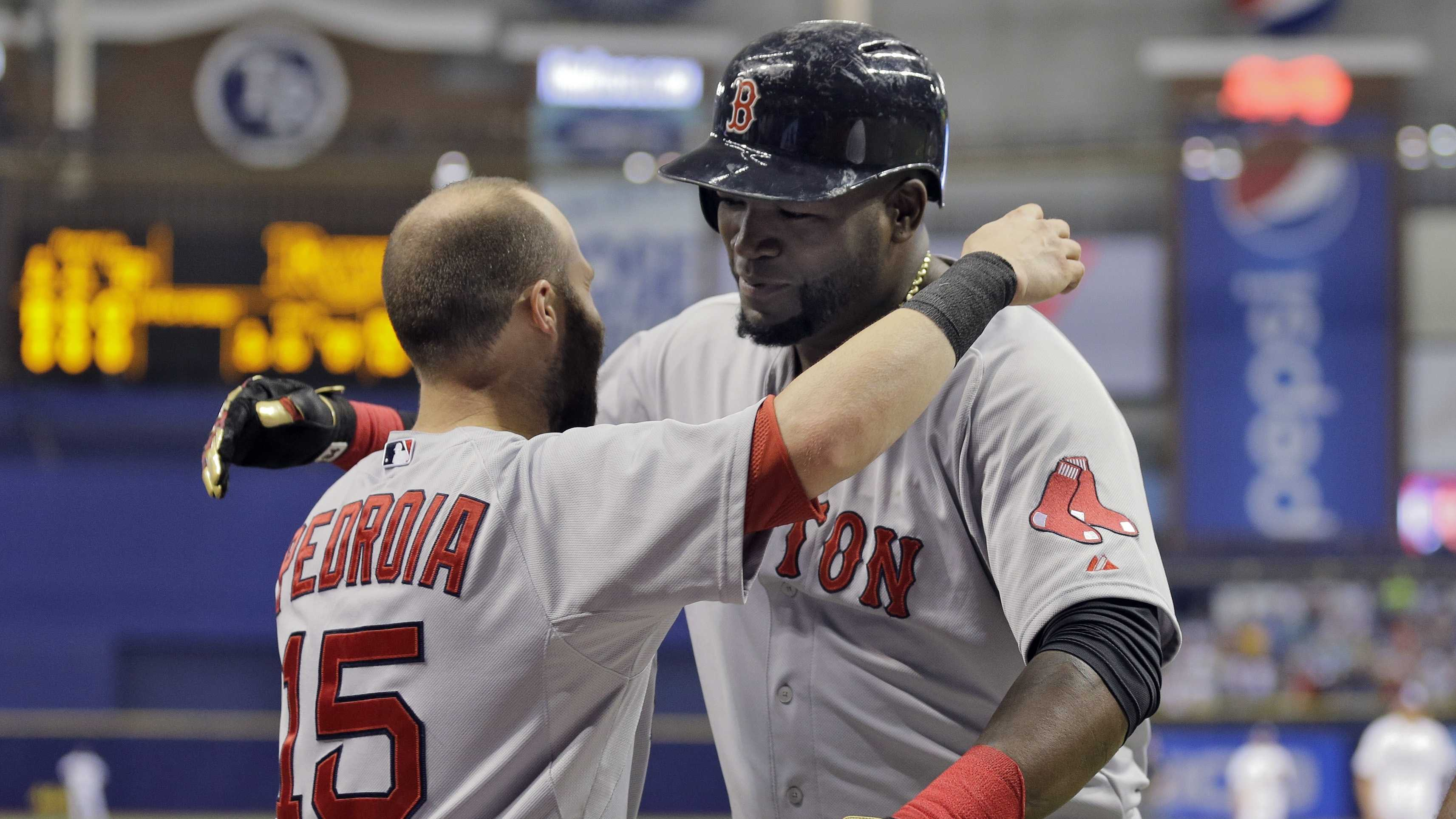 Boston Red Sox's David Ortiz, right, hugs Dustin Pedroia after Ortiz hit his 500th career home run off Tampa Bay Rays starting pitcher Matt Moore during the fifth inning of a baseball game Saturday, Sept. 12, 2015, in St. Petersburg, Fla.