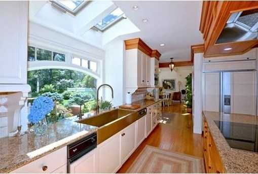 Complementing the fireplaced kitchen and dining room is a well appointed butler's pantry
