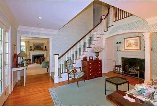 With 6 fireplaces thru out the first level, including the gracious entrance foyer, this home is ideal for both family and entertaining.
