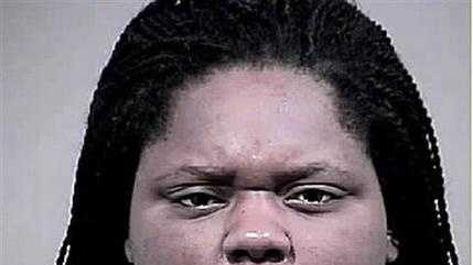 This photo provided by the Charles County, Md. Sheriff's Office shows Romechia Simms. Simms, who was found pushing her dead son in a playground swing earlier this year, has been indicted and charged with manslaughter and child abuse, authorities announced Monday, Sept. 14, 2015.