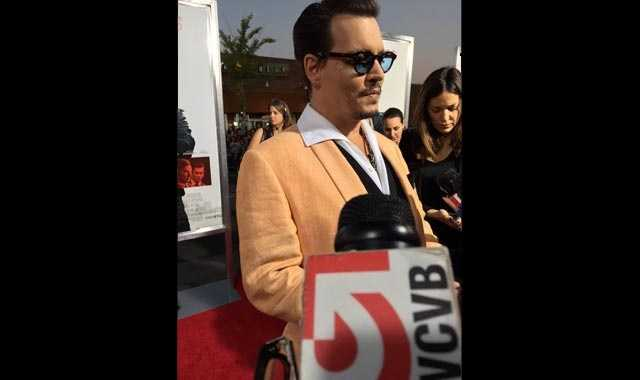"Actor Johnny Depp speaks with reporters, including NewsCenter 5's Ed Harding, before the premiere of ""Black Mass"" in Brookline on Sept. 15, 2015."