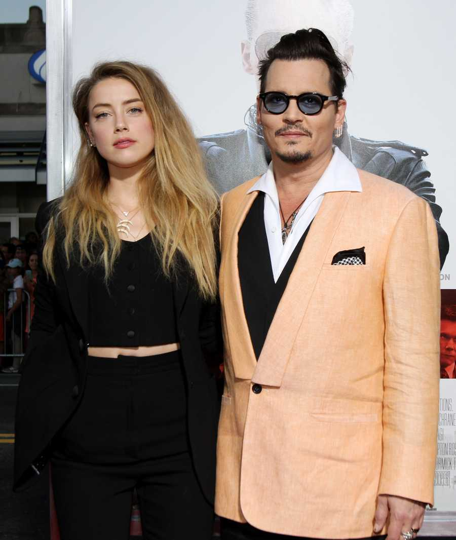 "Amber Heard, left, and Johnny Depp attend the Special Screening of ""Black Mass"" at the Coolidge Corner Theatre on Tuesday, Sept. 15, 2015 in Brookline, Mass. (Photo by Marc Andrew Deley/Invision/AP)"