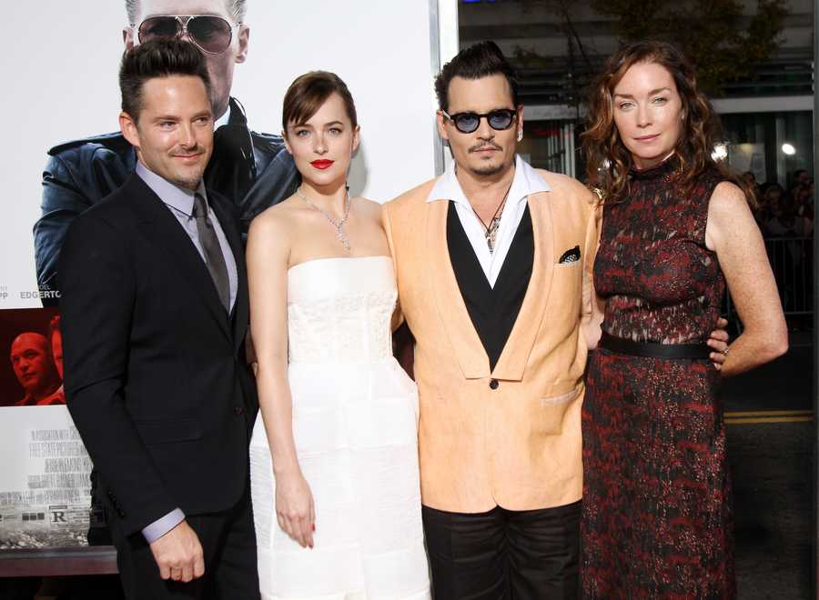 "Director Scott Cooper, from left, Dakota Johnson, Johnny Depp and Julianne Nicholson attend the Special Screening of ""Black Mass"" at the Coolidge Corner Theatre on Tuesday, Sept. 15, 2015, in Brookline, Mass. (Photo by Marc Andrew Deley/Invision/AP)"