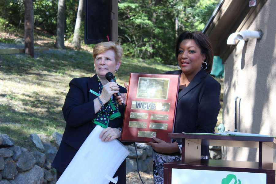 WCVB Director of Community Affairs Karen Holmes Ward accepts a plaque of appreciation from Girl Scouts of Eastern Massachusetts COO Barbara Fortier