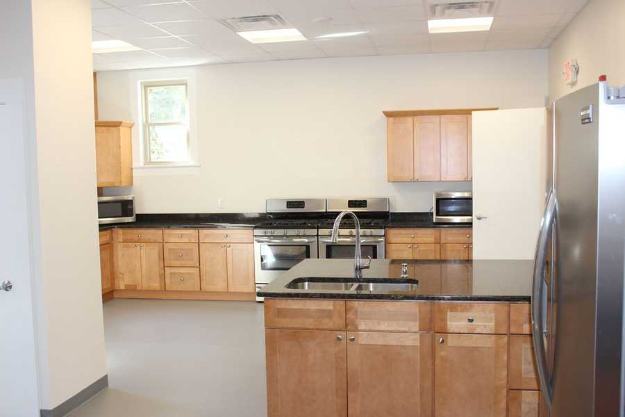 "The ""new"" Great Hall includes new flooring, cabinetry, counters, appliances, flooring, HVAC, and more."