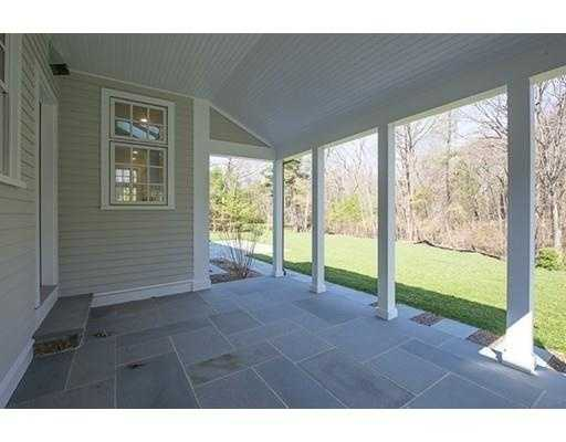 Covered open porch off the mudroom, large level private back yard, located near the Wellesley line and all major highways.