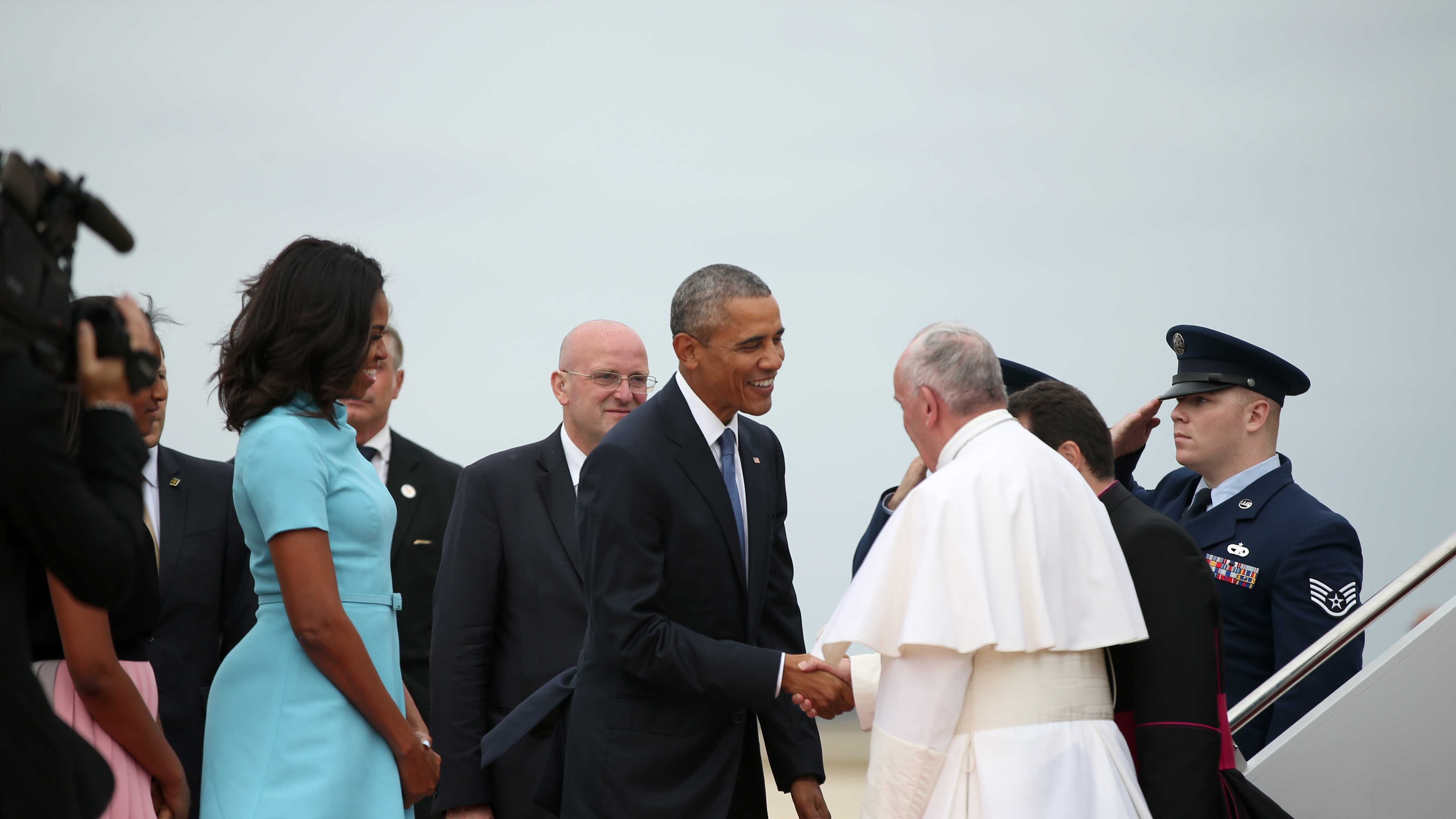 President Barack Obama, first lady Michelle Obama, and others, greet Pope Francis upon his arrival at Andrews Air Force Base, Md., Tuesday, Sept. 22, 2015. (AP Photo/Andrew Harnik)