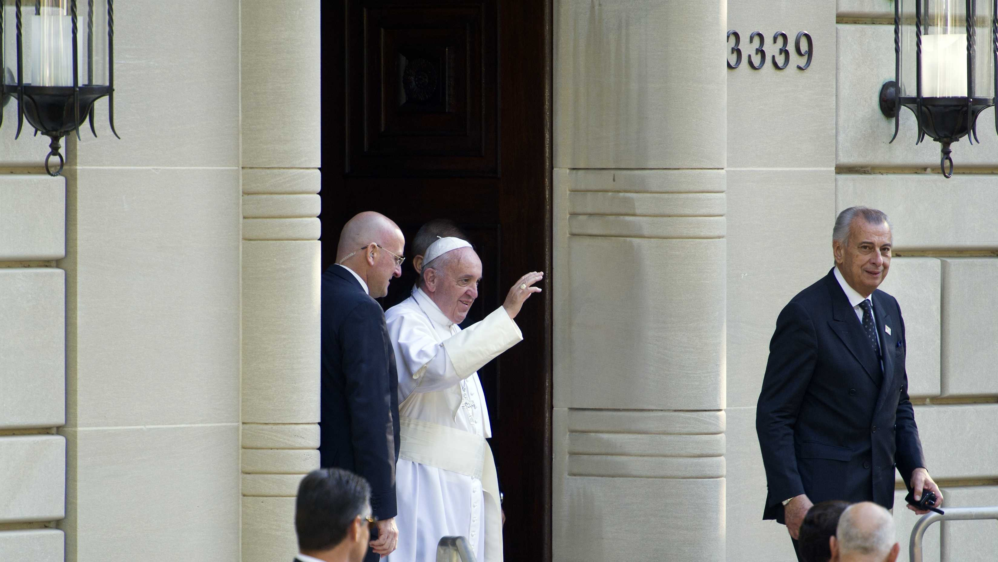 Pope Francis waves as he departs the Apostolic Nunciature, the Vatican's diplomatic mission in Washington, Wednesday, Sept. 23, 2015, for the White House where President Barack Obama will host a state arrival ceremony.