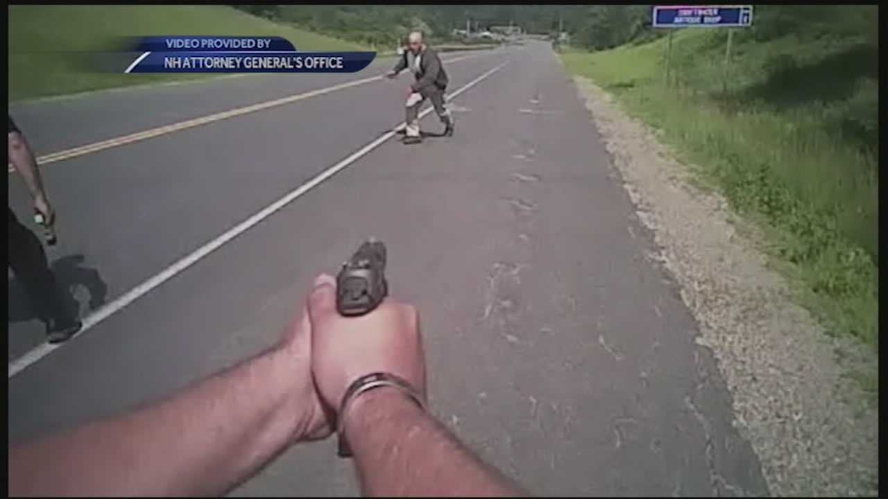 A dashboard camera video released Friday shows two police officers fatally shooting a knife-wielding man as he ran toward them along a rural road in July, then firing several more times after he fell at their feet.